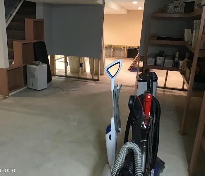Flood cuts in drywall, drying equipment at work.